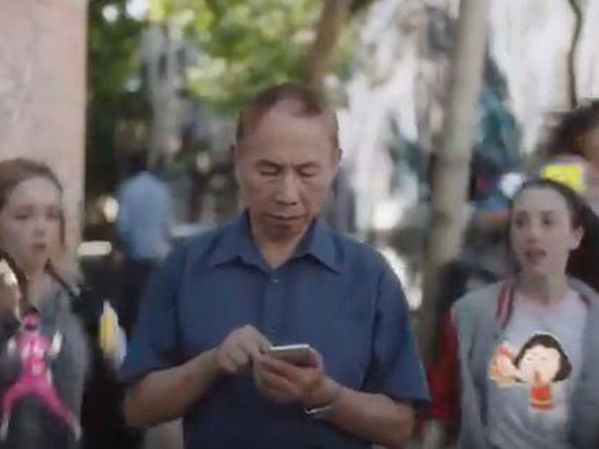 Commentary: A new iPhone 7 ad shows young, attractive people physically running around and slapping strangers with stickers. It's all very aggressive.