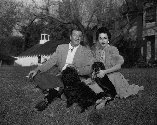0 john wayne with wife pilar and their dogs