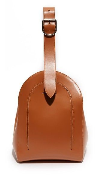 A structured MM6 bag in smooth leather. Slim front pocket. A magnetic flap covers the top.