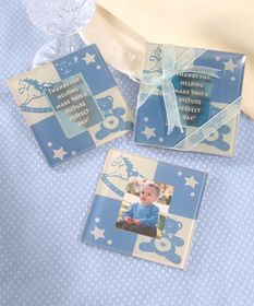 "Baby photos are always a source of great conversation and heartwarming smiles. So these useful and decorative glass photo coaster favors are guaranteed to be a hit with your baby-loving crowd! Featuring an alternating ivory and blue block pattern decorated with a rocking horse, teddy bear and star designs, each 3.75"" square coaster holds a photo (1.5""x 2"") at its center. #timelesstreasure"
