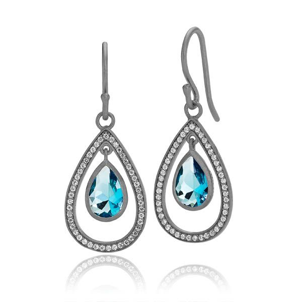 GODDESS earrings with pendants of open drops with white sparkling zirconias in matt black sterling silver and a big blue sparkling zirconia is dangling from the center of each earring - Danish design jewelry by Izabel Camille. Price: EUR 130 No. A1197ssr-blue www.izabelcamille.com