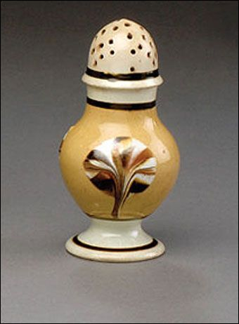 Mochaware - British pearlware mochaware dipped fan pattern pepper pot, ca. 1820. Of baluster form, banded in dark brown with three dark brown, rust, tan, and white fans on a butternut slip field, 4 1/2