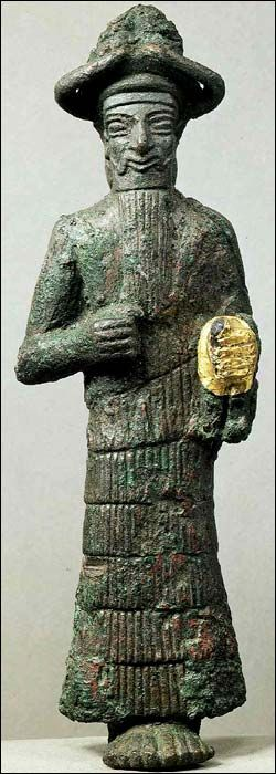 ca. 2000 BCE Elamite God with a gold hand, copper and gold. Susa, Discovery location Khuzestan, Iran. Louvre.