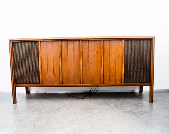 Great Quality and condition in this mid century modern RCA victor VJT 19W stereo console. We have our Technician tune and repair all of our consoles and this one is ready for your home. All electronics in this solid state stereo work as intended. The wood cabinet is in great shape with no damage to be seen. Everything is original on this piece. This piece looks as good as it sounds and is a great addition for any mid century modern home. RCA made some of the higher end stereos of this era…