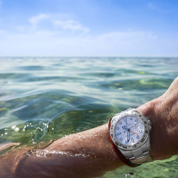 "Favourite Colours of Autumn  This week's #head2headcopycat. Rolex Explorer II 216570 ""Polar"" in the crystal clear and warm Mediterranean Sea."