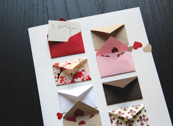 valentine with a series of tiny messages and heart shaped confetti inside of tiny envelopes—love!