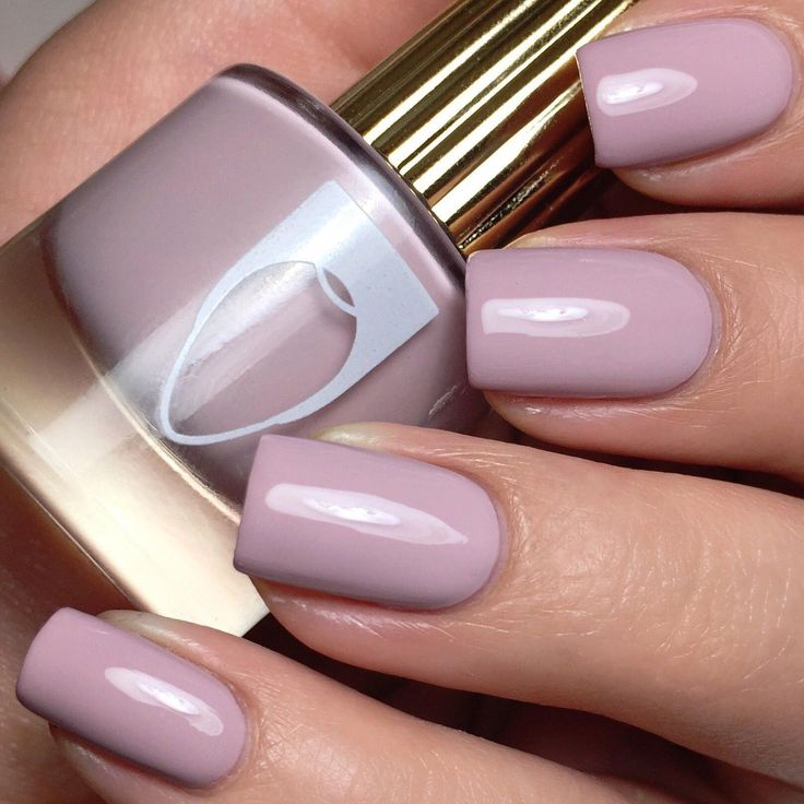 Get all the pleasures of wearing this light purple with a hint of gray creme nail polish on your nails.