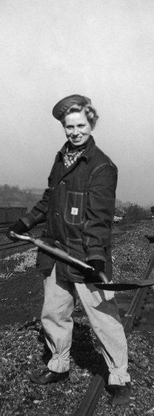 Female railroader working hard during WWII, brilliant denim jacket