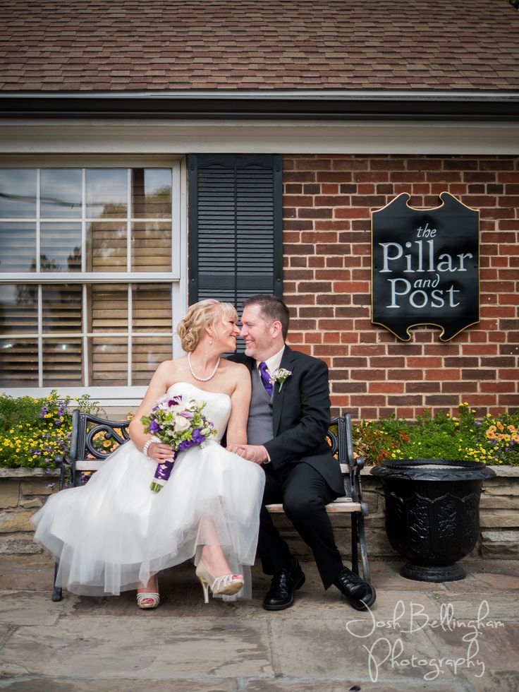 Cute wedding couple snuggling on a bench in front of the amazing Pillar and Post. Vintage Hotel Weddings at Pillar and Post are perfect for an intimate ceremony. @vintagehotels  #JoshBellinghamPhotography www.joshbellingham.com