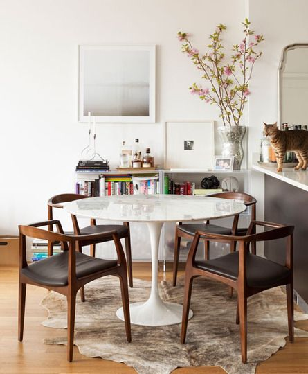 the classic elbow chair and white 120cm tulip table. Perfect for a relaxed and stylish dining setting