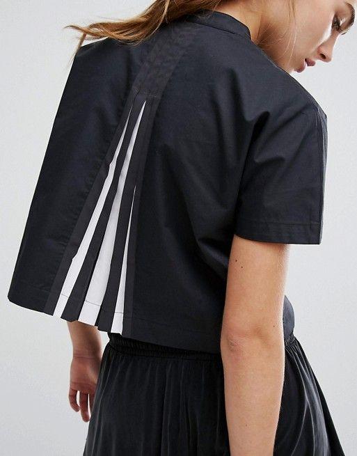 Compra Top con espalda plisada de adidas Originals en ASOS. Descubre la  moda online.