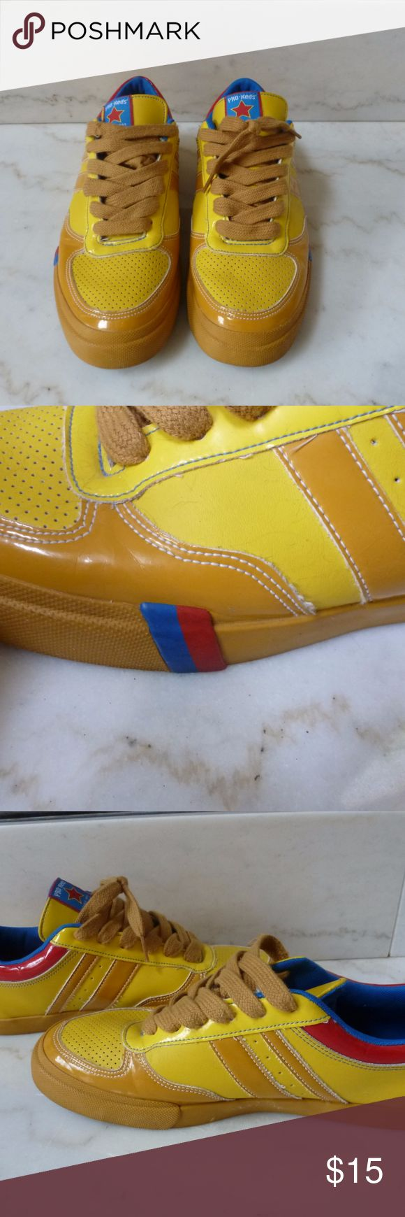 Men's wild yellow Pro Keds An instant attention getter, these Pro Keds are done in bright yellow with dark yellow, blue, and red accents.  In excellent condition.  Men's size 9.5 Pro Keds Shoes Sneakers