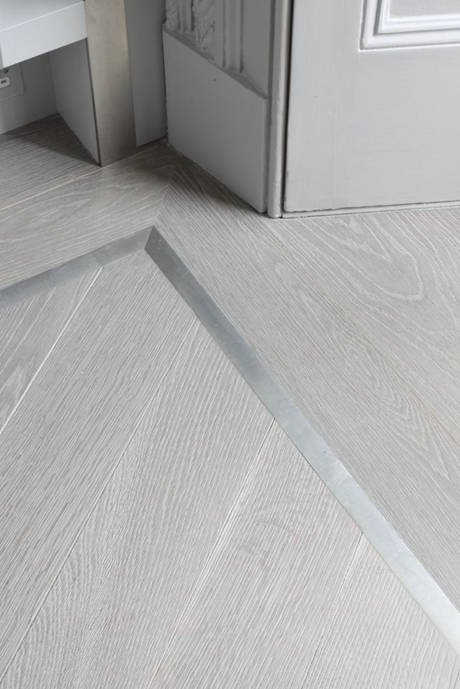A striking pewter border complements the ash grey engineered wood flooring here www.element7.co.uk