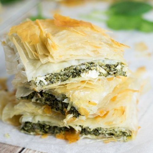 Spanakopita, Greek Spinach Pie, packed with spinach and feta cheese filling between flaky phyllo dough layers!