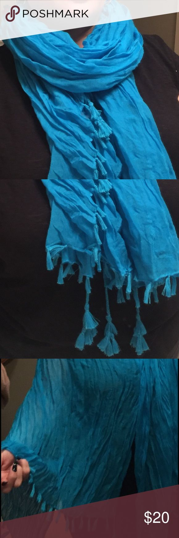 "70 x 35"" Light Weight Scarf with Tassles This bright blue scarf is made of a light weight, soft, wrinkled-look fabric. It has fringe along each edge and tassels in the corners.  It could be worn many ways. Smoke and pet free home. Accessories Scarves & Wraps"