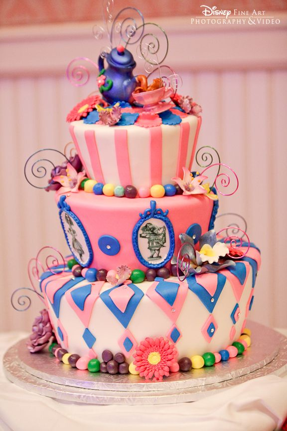 Blue and pink mad hatter style wedding cake