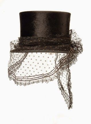 Riding top hat: 1863-65  Riding top hat. Beaver felt riding hat with a lace veil, dated c. 1864. This hat was retailed by W.C. Taylor.  Artist/Photographer/Maker Unknown  Date 1863 AD - 1865 AD  Museum of London