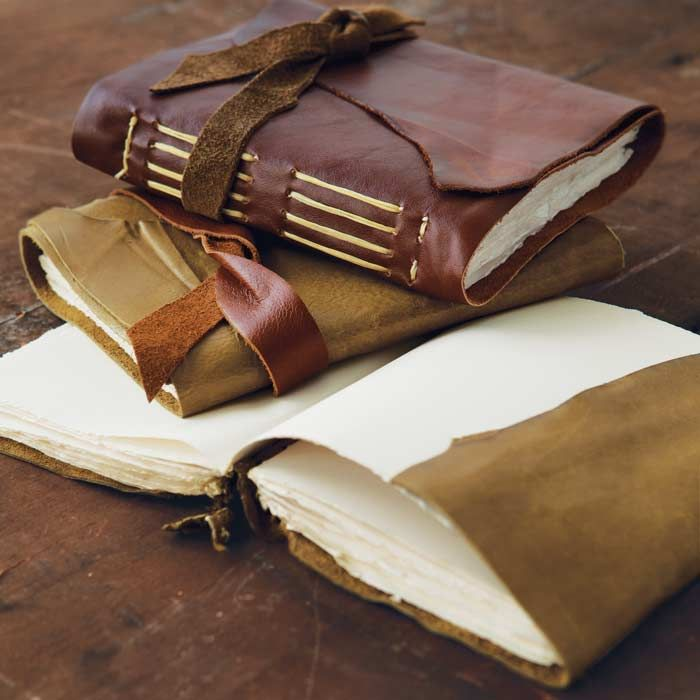 Leather wrap journals-beautiful! These are the types of books I like to make, I especially like the binding.