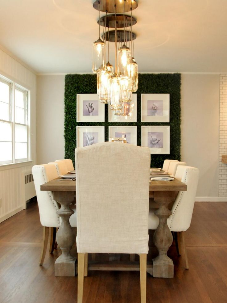 Cream tones and rustic details were selected for this home near the ocean for a coastal look. Designers Anthony Carrino and John Colaneri also added panels of faux boxwood leaves to create an earthy feature wall.