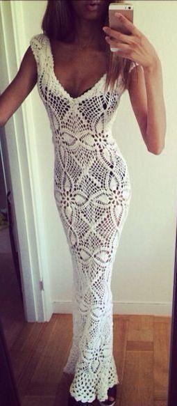 Pretty white crocheted dress, worn on a great figure. But why wear black underwear?!