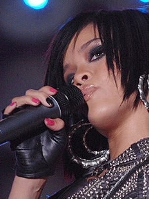Rihanna sporting a dark polish on her middle finger. | Celebrity Nail ...