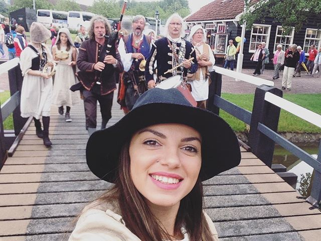 """""""TBT to a selfie with a dutch music band at a touristic windmill village near Amsterdam. They were following me, so I couldn't help it... 😊📸 ahhh those young cabin crew days"""" by (rayyakutsarova). cabincrew #holland #amsterdam #tourist #europe #layover #throwback #netherlands #clogs #village #musicband #windmill #smile #instatravel #travelgram #dutch #tbt #selfie #ams #zaanseschans. [Follow us on Twitter at www.twitter.com/MICEFXsolutions for more...]"""