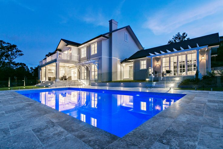 Hamptons exterior, swimming pool laid with french pattern travertine