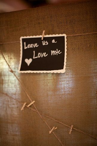 Had a unique guest book idea. Guests were encouraged to leave a love note for the newly married couple. Chalkboard paper was provided for their guests to use and a twine peg line hung ready for their love notes to be pegged. I love the twine and clips, and love notes. But color palate appropriate scrapbook paper would be cuter than the chalkboard paper!
