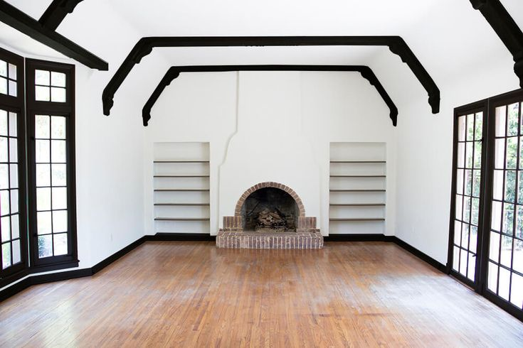 all-black-living-room-emily-henderson_house_living-room_painting_trimwork_white-walls-black-baseboards-black-trim-and-black-beams