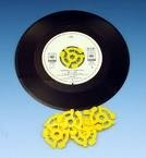 45 rpm (revolutions per minute) vinyl records needed plastic inserts - here's your answer to the other one.