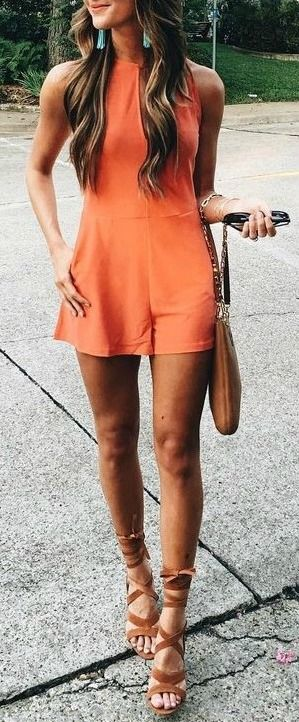 Orange romper + lace up heels.