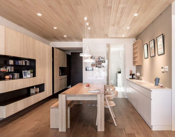 Apartment: Dining Room Decor Ideas Featuring Solid Wooden Dining Table And Rustic Chairs Beneath White Lighting Fixture Mixed With Sleek White Cabinet Plus Built In Shelves Ideas: A Modern Apartment Celebrates the Look of Natural Wood