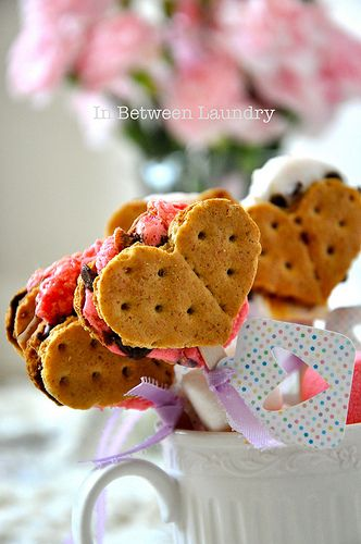 Heart-shaped s'more pops from In Between Laundry.  YUM! #smores #heart #valentines