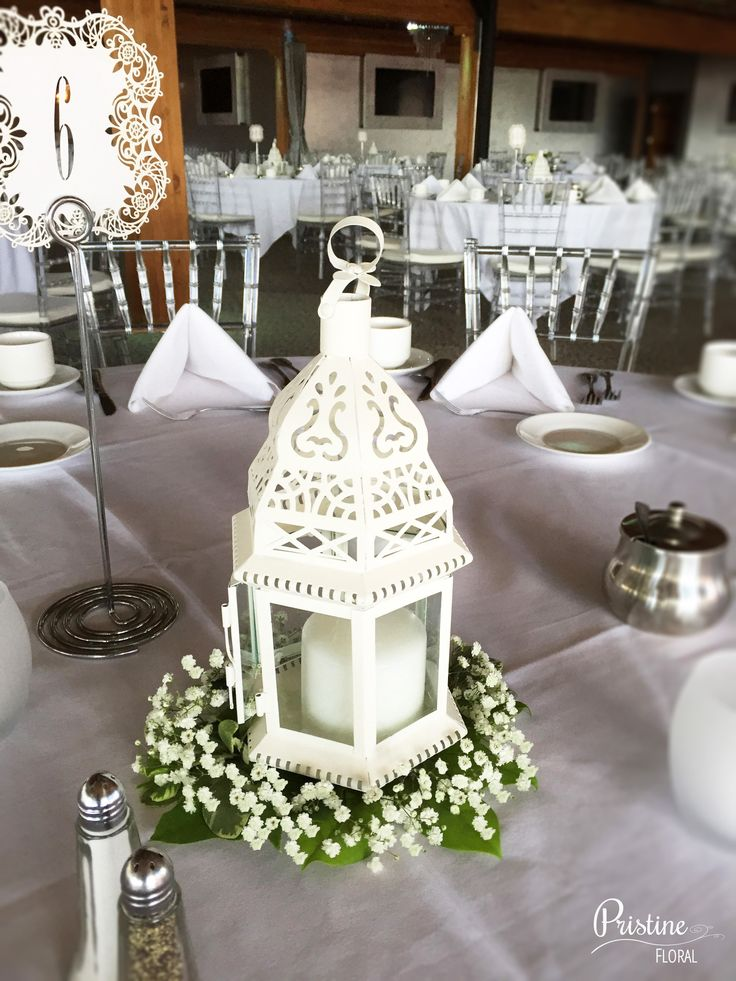Lovely Lantern Centerpiece finished with Greenery & Baby's ...