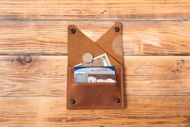 This genuine leather card wallet is made of high quality Italian calfskin and high quality German YKK snap fasteners. To keep it from wearing out, the base and inside are produced from thick...