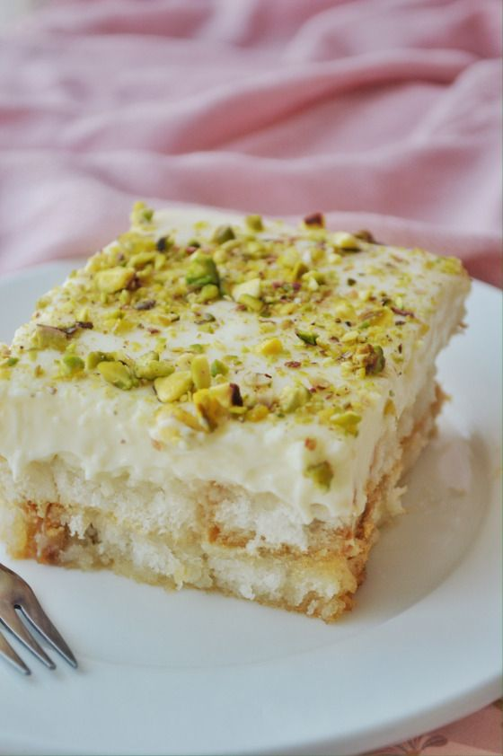 AISH EL SARAYA ~~~ aish el saraya is a beloved bread pudding. the share at this post's link is made of toasted bread , custard, pistachio, and orange blossom water simple syrup. [West Asia] [savoryandsweetfood]