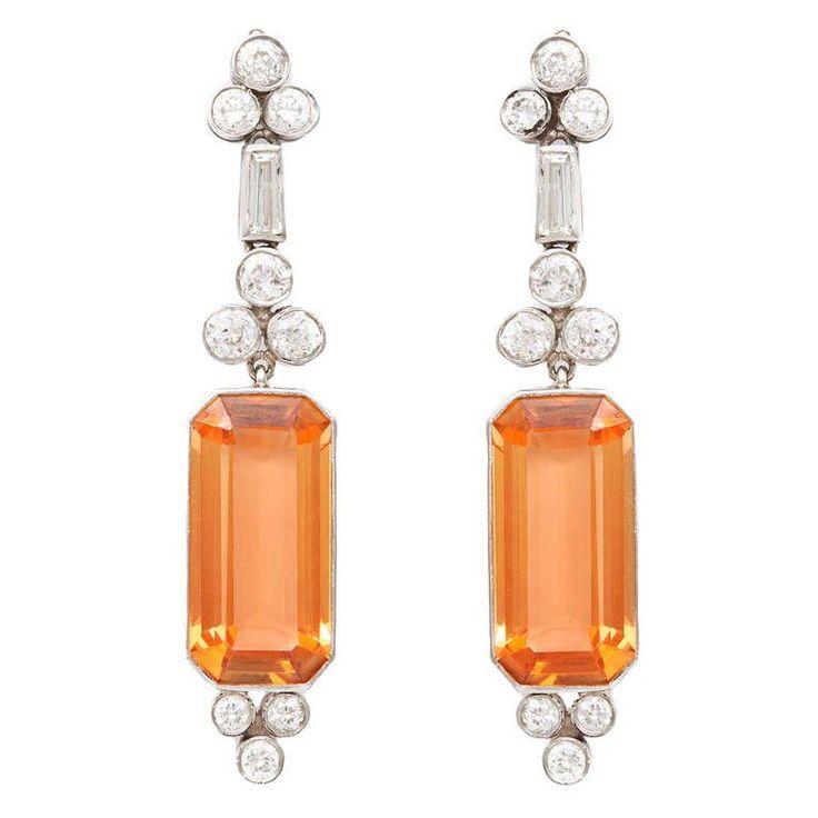 Art Deco Topaz Diamond Earrings. Pair of precious topaz pendant earrings with round and baguette diamonds, set in platinum. c1930