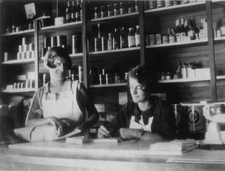 """The store at Te Atatu Peninsula. By the 1930s there were about 50 houses on the peninsula and along with a hall, a school and the church there was a general store with Post Office facilities and a petrol pump. """"The first post office for Te Atatu was opened on 1st July 1907 as an agency... In June 1955 a small wooden building was constructed... It was used until 1961 when post office operations were moved to leased accommodation. The 1955 building was then moved to East Tamaki."""" : I. Clulee."""