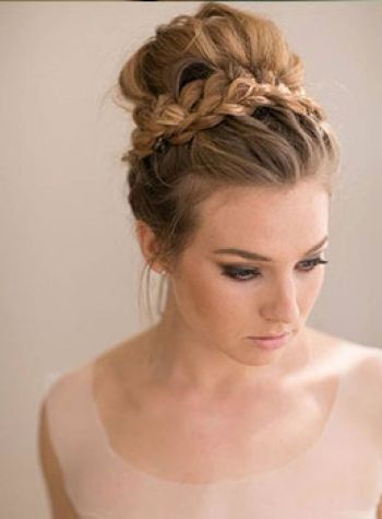 (Air control)Pull curled hair into a messy bun, leaving out a chunk of hair just above either ear. putting this hair into a braid and tying around the base of the bun