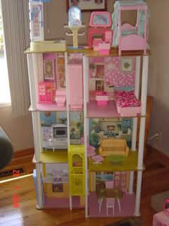 One of my favorite childhood memories is playing with my Barbie Townhouse. I loved the elevator!
