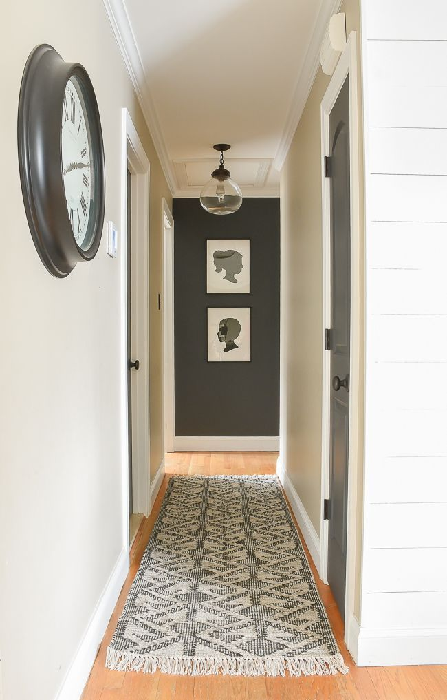 A Small Narrow Hallway Gets A Sleek Modern Makeover With Lots Of Contrast And Texture Hallway Moder Narrow Hallway Decorating Small Hallways Narrow Hallway