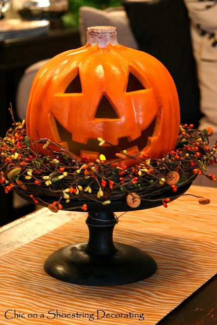 Simple candle pedestal, Autumn wreath, and ceramic Jack-O-Lantern. Chic on a Shoestring Decorating