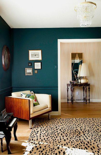 dark walls + leopard rug.