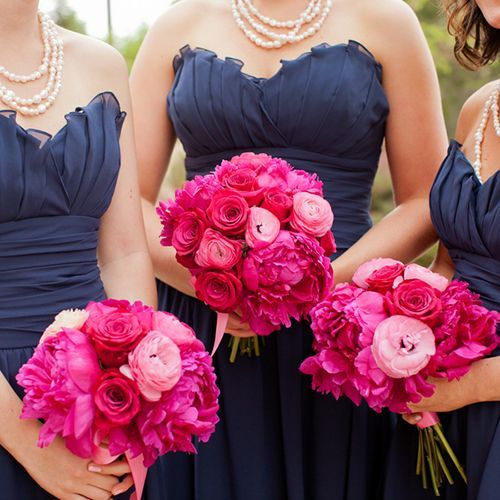 hot pink and light pink bouquets featuring ranunculus, peonies, and roses
