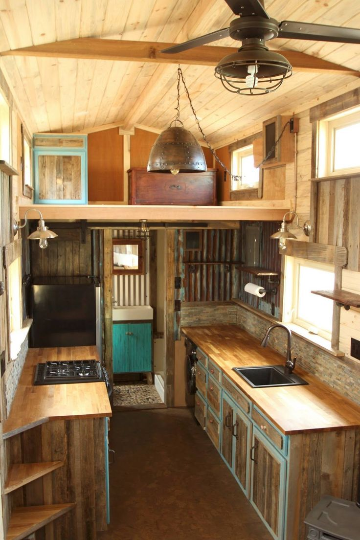 A beautiful custom rustic home from SimBLISSity Tiny Homes. Made from a pine and corrugated metal exterior with a warm, cabin-like interior.