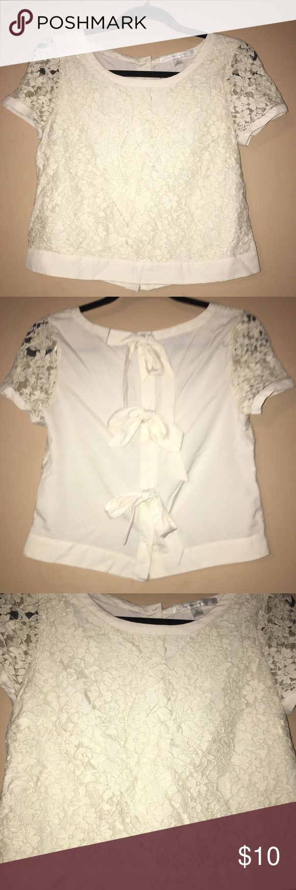 Lauren Conrad Bow Back Shirt Short sleeve shirt in a lace ivory color with bows in the back. You can tie the bows however you'd like, I tried tying them but I don't really know how to. It's in perfect condition! It looks like it was never worn. Brand is Lauren Conrad and size is extra small  Bundle with my other listings to save on shipping! LC Lauren Conrad Tops Blouses