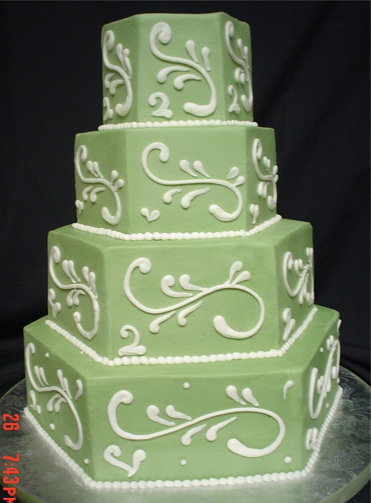 Green may not be everyone's first choice but for a Spring or Garden wedding this would fit right in. Buttercream finish with green swirls and gumpaste flowers ~ designmeacake.com