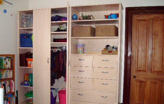 storage solutions in children's room, including clothing rail at lowered height - Living Room, Wellington