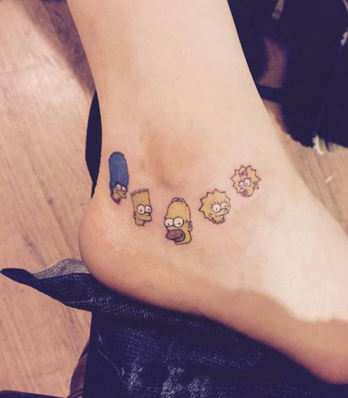 The Simpsons family tattoo on the left inner ankle. Tattoo...