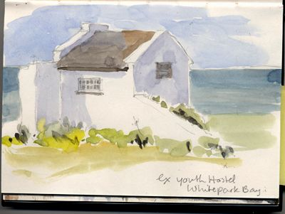 This little building used to be the Youth Hostel. At Whitepark Bay, North Antrim Coast, Northern Ireland. Watercolour, Kathy Lewis